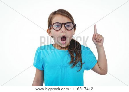 Cute girl shaking finger saying no to the camera on white screen