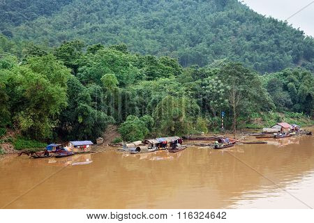 Floating village with fishing boats