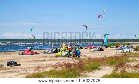 Kitesurfers On The Beach Prepare Equipment For Riding