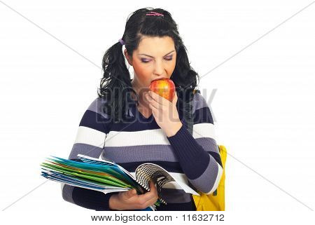 Student Girl Reading And Eating Apple