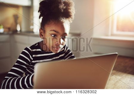 Black Teen Girl Watching Movie On Laptop Seriously