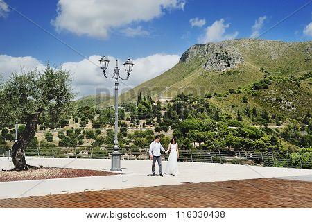 Happy Couple Holding Hands In Sperlonga, Italy