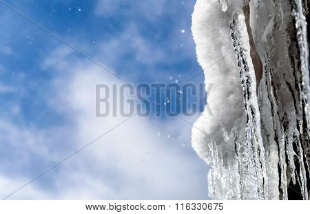 Icicles Hanging On The Snowy Mountain