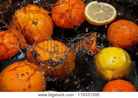 Citrus Fruits Are Floating In Water
