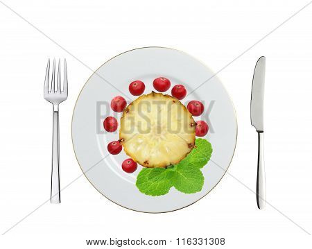 Plate With Sweet Slice Of Pineapple, Cranberry And Mint Herb, Knife And Fork Isolated On White