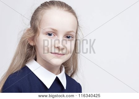 Friendly And Beautiful Caucasian Blond Girl With Wonderful Deep Eyes. Positive Facial Expression