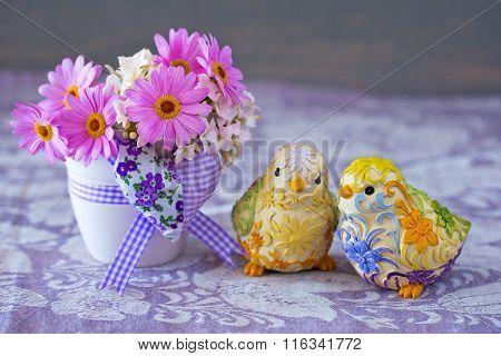 Two decorative birds