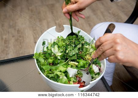 Cook make salad from greens