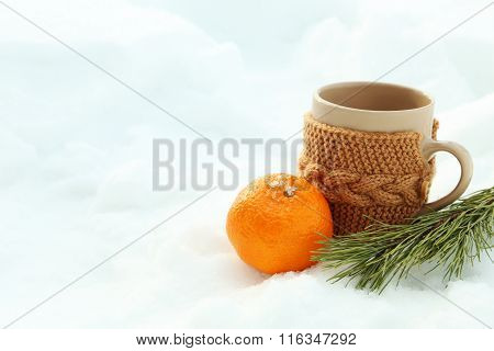 Ripe Mandarin And Cup With Fir-tree Branch On The White Snow