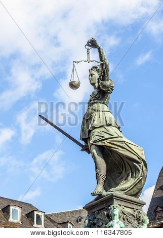 FRANKFURT, GERMANY - MAY 4, 2013:  Statue of Lady Justice in front of the Romer in Frankfurt - Germany