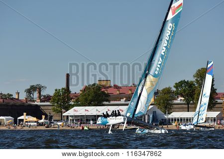 ST. PETERSBURG, RUSSIA - AUGUST 20, 2015: Catamaran of Oman Air sailing team during 1st day of St. Petersburg stage of Extreme Sailing Series. Red Bull Sailing Team won the day with 58 points