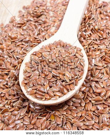 Closeup Of Flaxseed On Wood Background