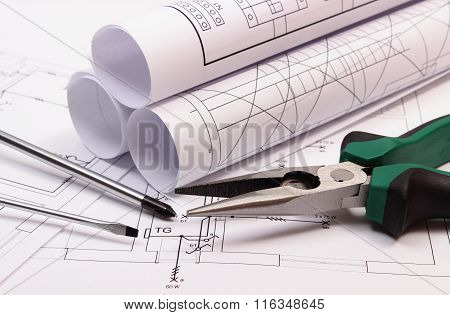 Rolls Of Diagrams And Work Tools On Electrical Construction Drawing Of House