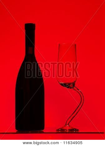 A bottle of red wine and wine glass