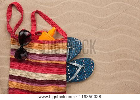 Beach Bag With Sunscreen, Flip Flops, Sunglasses.