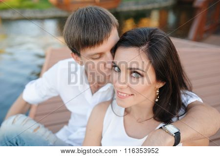 Man Kissing A Beautiful Woman On The Cheek Couple