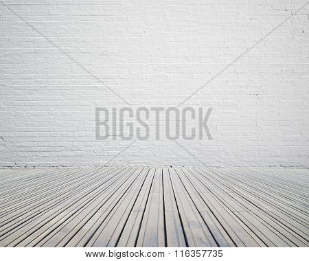 Room With White Brick Wall With Wooden Floor