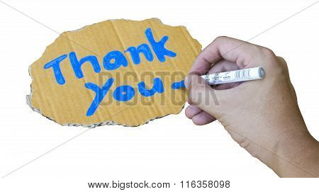 isolated thank you wording on cardboard by hand