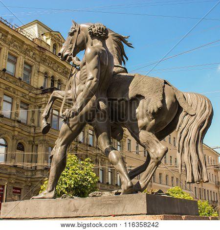 Sculpture Of A Man Next To A Horse
