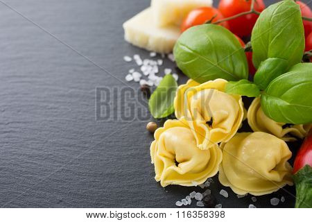 Homemade raw Italian tortellini with ham and cheese