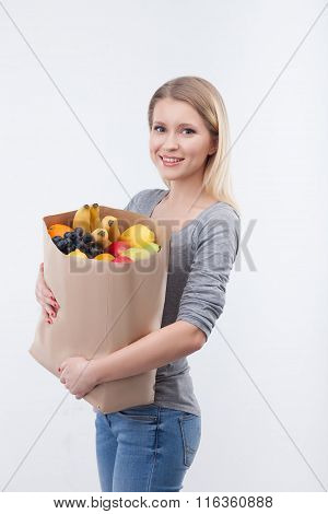 Cheerful young woman with natural organic products