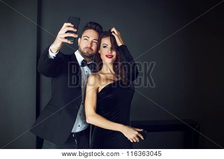Fashionable Rich Celebrity Couple Taking Selfie