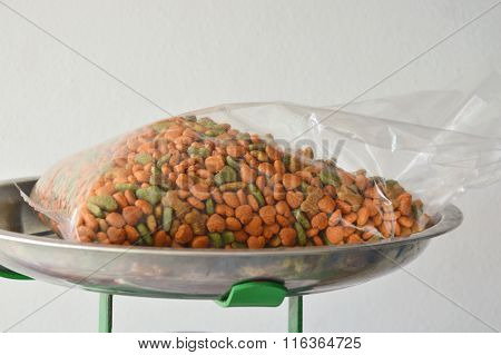 dog food in plastic bag on weighing scale tray