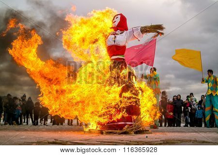 St. Petersburg, Russia - February 22, 2015: Burning of dolls to celebrate the arrival on holiday Mas