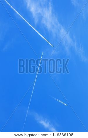 Deep Blue Sky With Many  Contrails