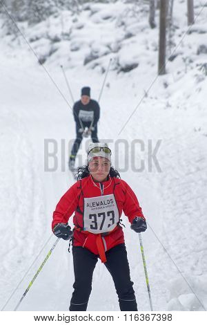 STOCKHOLM - JAN 24 2016: Cross country skiing woman followed by a man at the Stockholm Ski Marathon event January 24 2016 in Stockholm Sweden