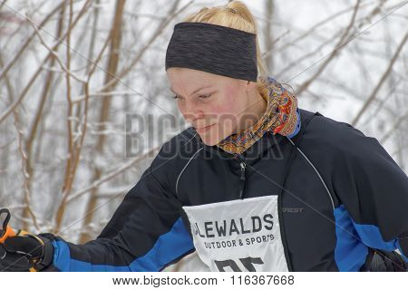 Close Up Of A Cross Country Skiing Woman In The Forest