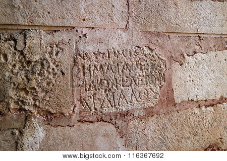 Demre, Turkey - April 26, 2014: Church of St. Nicholas. Antique writing on the wall.