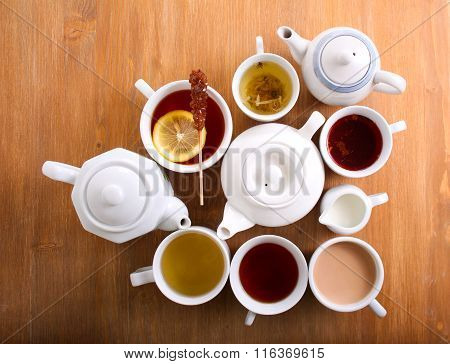 Sorts Of Tea In The Cups And Tea Pots