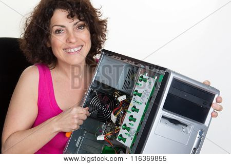 Girl Repairing The System Unit At Business Place