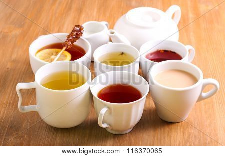 Sorts Of Tea In The Cups And Tea Pot