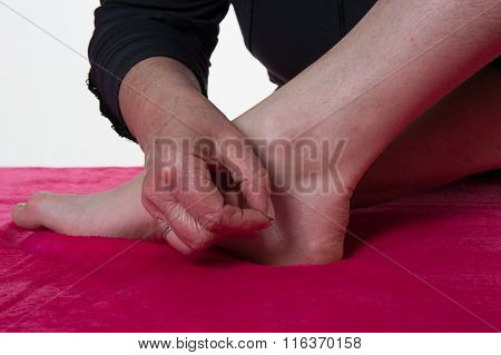 A Patient Receives A Foot Acupuncture