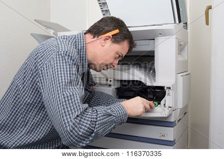 Frustrated Technician Man Opening Photocopy Machine In Office To Fix Problem