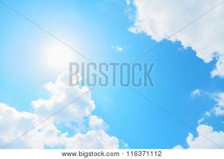 Bright Sun And White Clouds