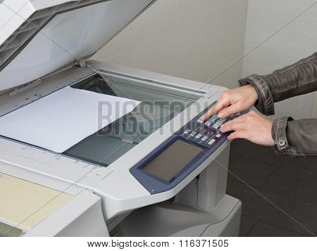 The Finger Pressing The Buttons Of The Copier At Office