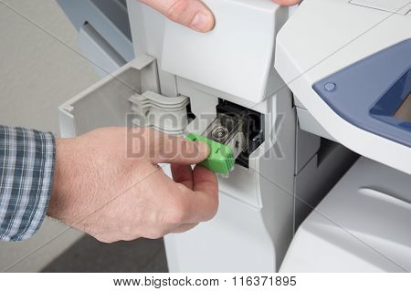 Closeup Shot Of Technician Fixing Photocopier Machine