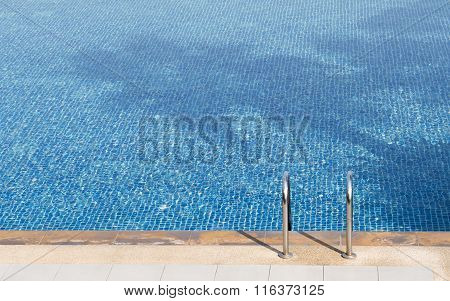 The Swimming Pool Ladder Of Blue Pool With A Shadow Of Coconut Tree