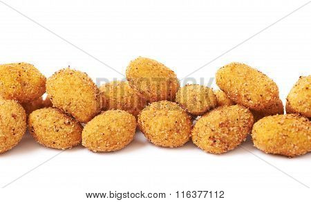 Line of crunchy coated nuts