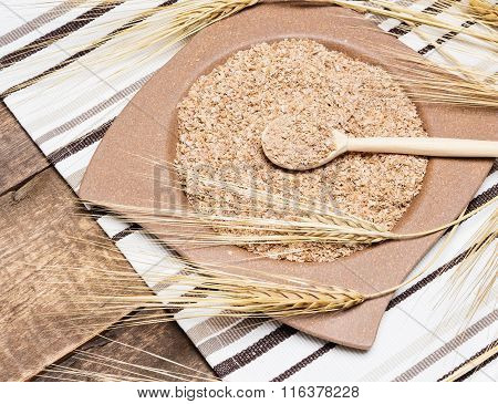 Wheat Bran In Bamboo Plate With Wheat Ears