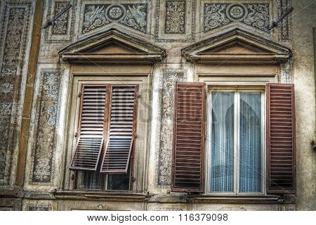 Windows In A Painted Wall In Florence