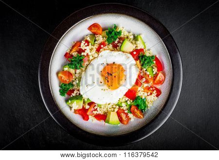 Salad With Millet, Avocado, Cherry Tomatoes And Fried Egg