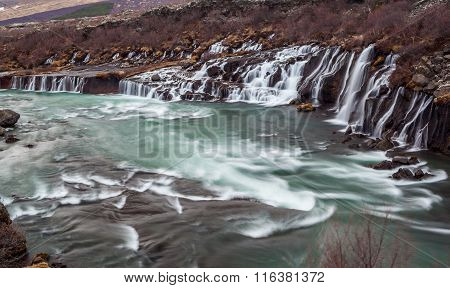 Hraunfossar Cascade  Waterfall In Iceland.