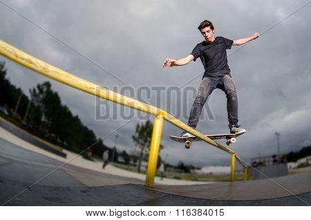 Skateboarder Doing A Board Slide