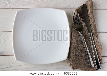 White Plate And Cutlery On A Napkin