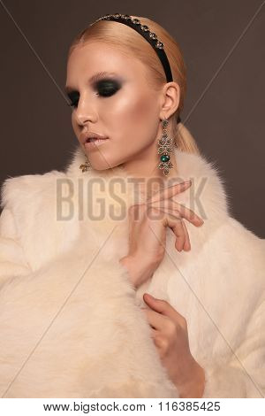 Woman With Blond Hair And Smokey Eyes Makeup,wears Luxurious Fur Coat