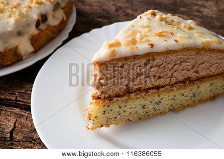 Homemade Cake With Nuts On A White Plate Wooden Background